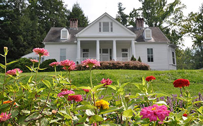 carl sandburg home national historic site with flowers in front
